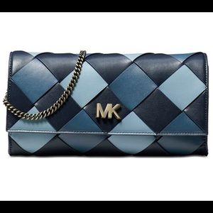 Michael KORS blue leather woven clutch.